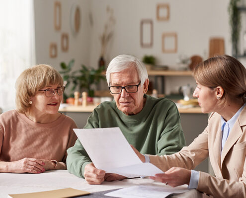 image of elder couple reviewing their will by Mullins Treacy Solicitors Waterford